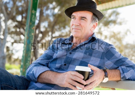 Portrait of an old man outdoors - stock photo