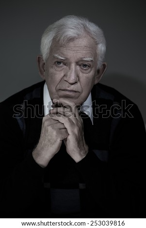 Portrait of an old man, vertical photo - stock photo