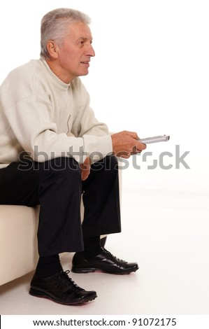portrait of an old man watching tv - stock photo