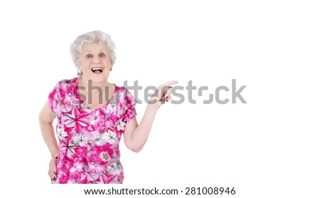 Portrait of an old woman doing a pointing gesture against a white background - stock photo