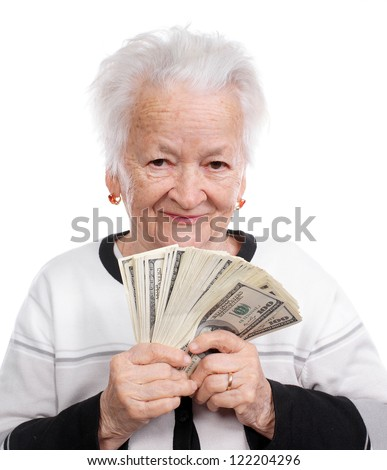 Portrait of an old woman holding money in hand on white background - stock photo
