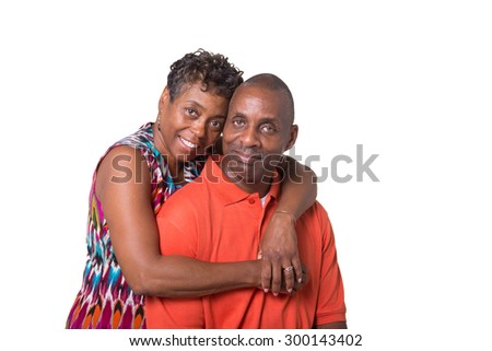 Portrait of an older couple embracing, isolated - stock photo