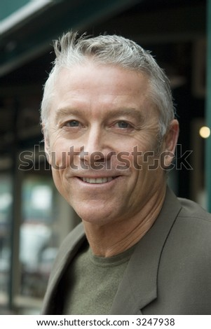 Portrait of an older man - stock photo