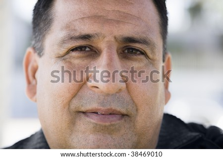 Portrait of an Overweight Man Looking Directly To Camera - stock photo