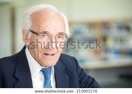 Portrait of an senior god looking business man with suit and old gray hair - stock photo
