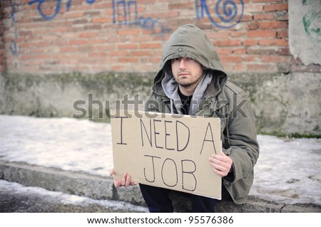 portrait of an unemployed man looking for a job - stock photo