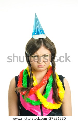 portrait of an unhappy brunette teenage girl celebrating her birthday - stock photo