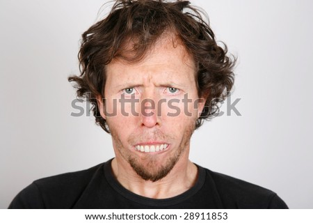 Portrait of an upset man with protruding teeth - stock photo