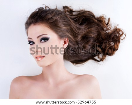 Portrait of an Young beautiful woman with  long brown hairs and fresh healthy skin. - stock photo