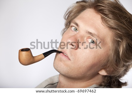 Portrait of an young wealthy man smoking pipe. See more in my portfolio