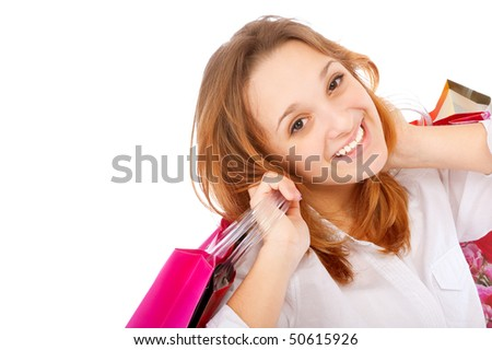 Portrait of an young woman holding several shoppingbag, isolated on white background. - stock photo
