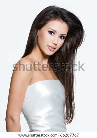 Portrait of an young woman with beautiful long brown hairs, posing isolated on white - stock photo