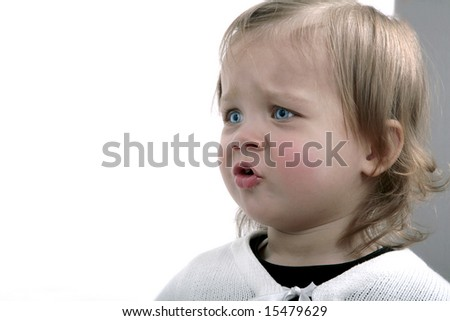 Portrait of angry baby girl - stock photo