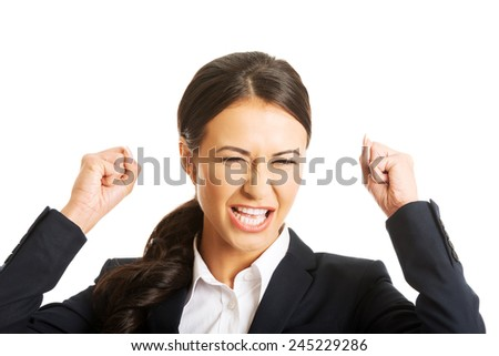 Portrait of angry businesswoman making fists and screaming. - stock photo