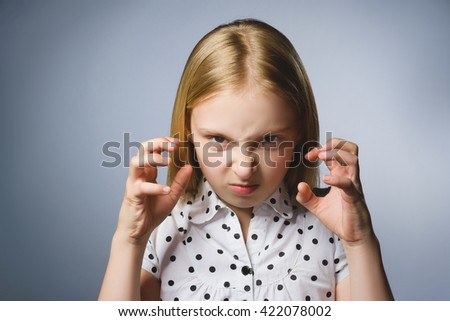 Portrait of angry girl with hands up yelling isolated on gray background. Negative human emotion, facial expression. Closeup - stock photo