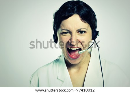 portrait of angry girl with headset - stock photo