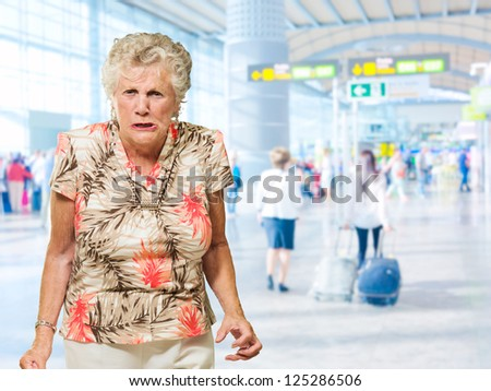 Portrait Of Angry Senior Woman, Indoors - stock photo