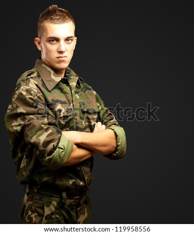 Portrait Of Angry Soldier against a black background - stock photo