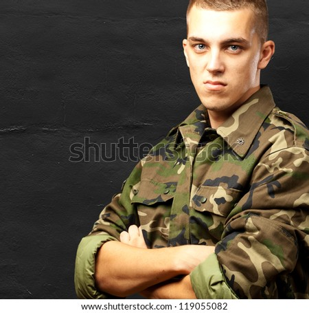 Portrait Of Angry Soldier against a grunge background - stock photo