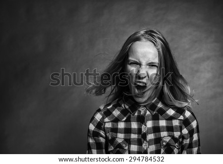 Portrait of angry teen girl - stock photo