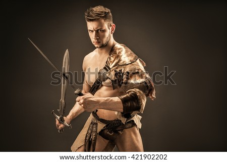 Portrait of angry warrior in leather clothes with swords - stock photo