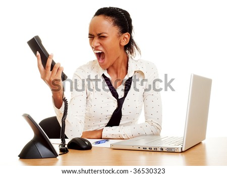 portrait of angry woman screaming at the phone