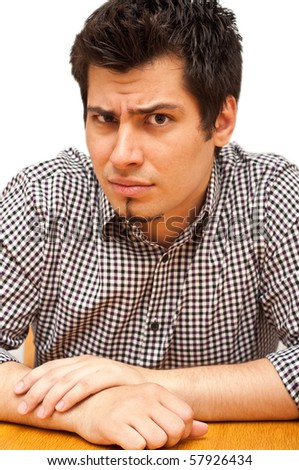 portrait of angry young man isolated on white - stock photo