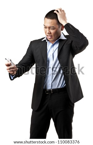 portrait of angry young man shouting using mobile over white background - stock photo