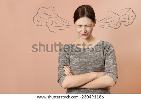 Portrait of angry young woman, Portrait of angry young woman with steam coming out of her ears -  Negative human emotions - stock photo