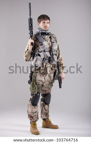 Portrait of Armed Soldier with two guns in a white studio - stock photo