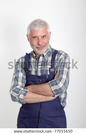 Portrait of artisan with arms crossed - stock photo