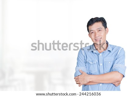 Portrait of asia businessman 40 - 50 year old in office - stock photo