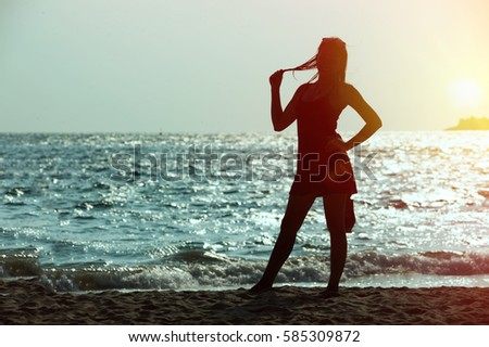 Portrait of asia young woman as silhouette by the sea