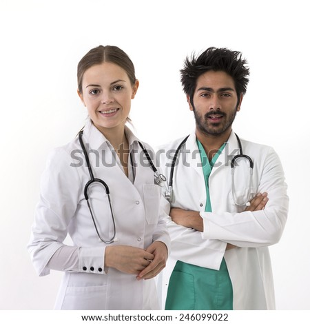 Portrait of Asian and Caucasian Medical professionals wearing medical scrubs and stethoscope. Isolated on white background.  - stock photo