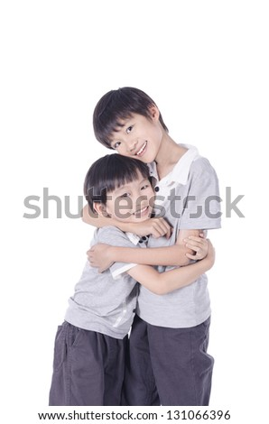 Portrait of Asian brothers hugging over white background