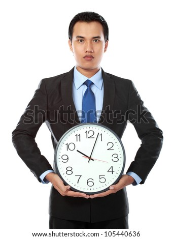 portrait of asian businessman holding a big clock isolated on white background - stock photo
