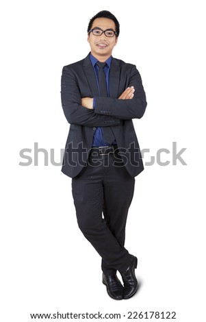 Portrait of asian businessman standing in studio, isolated on white background - stock photo