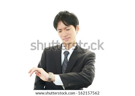 Portrait of Asian businessman who has no time - stock photo