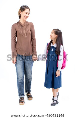 Portrait of asian child in school uniform holding hand with mother on white background isolated - stock photo
