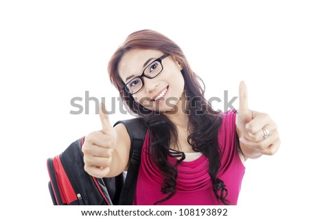 Portrait of asian college student showing thumbs-up. shot in studio isolated on white - stock photo