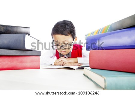 Portrait of asian elementary school student studying. Shot in studio isolated on white - stock photo