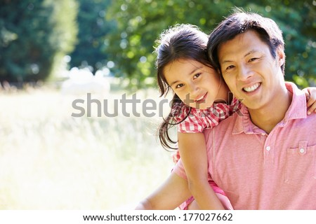 Portrait Of Asian Father And Daughter In Countryside - stock photo