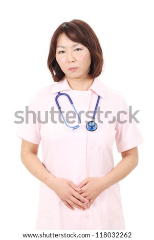 Portrait of asian female nurse with hands crossed