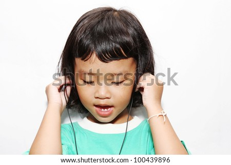Portrait of Asian girl,Girl listening to music.