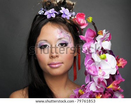 Portrait of asian girl with flowers