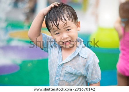 Portrait of asian kid very playful. Happiness and summertime - stock photo
