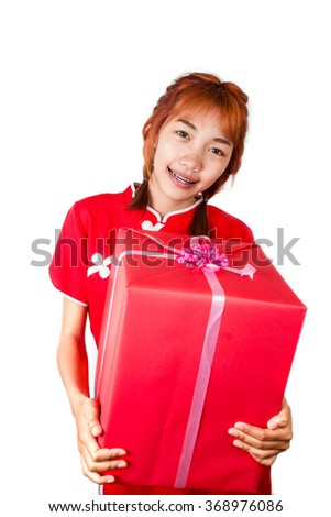 Portrait of Asian lady in red Cheongsam traditional dress suit holding red gift box. Isolated on white background, in the Chinese new year and valentines concept.