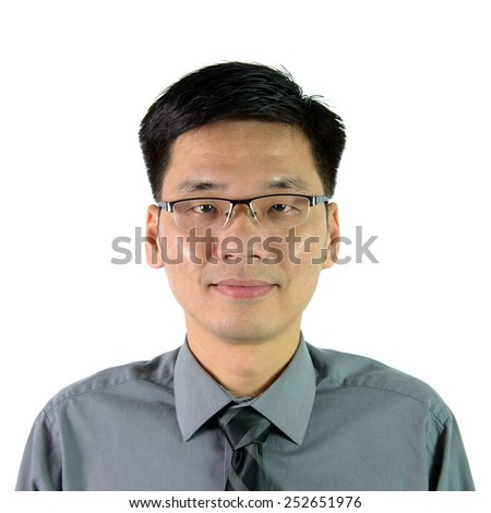 Portrait of Asian man in formal suit - stock photo