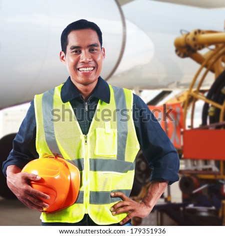 Portrait of asian professional engineer holding safety helmet at work - stock photo