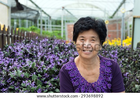 Portrait of Asian senior citizen smiling at lavender garden